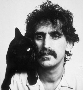 Frank Zappa poses with a cat in 1988. Location unknown. (AP Photo)